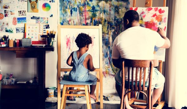 a dad and his son painting