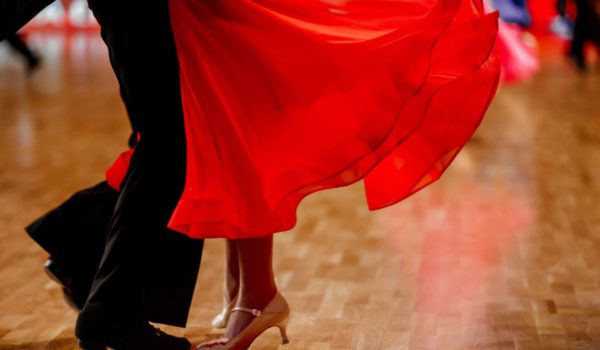 Red ball gown dancing